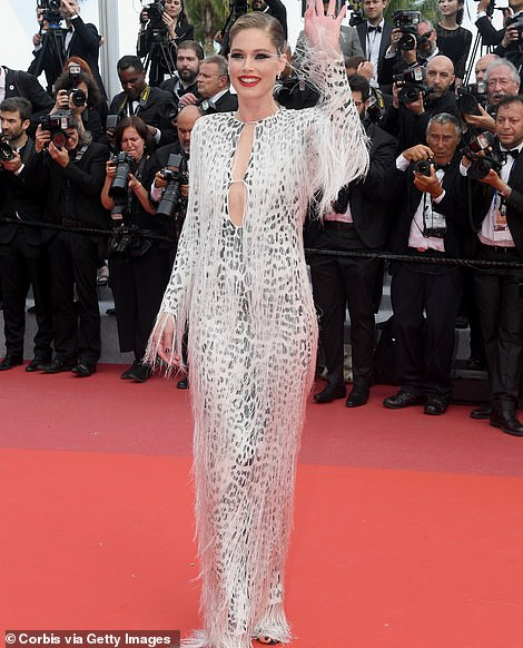 Beautiful: Dutch supermodel Doutzen Kroes, 34, oozed glamour in a white leopard print gown with a fringed overlay