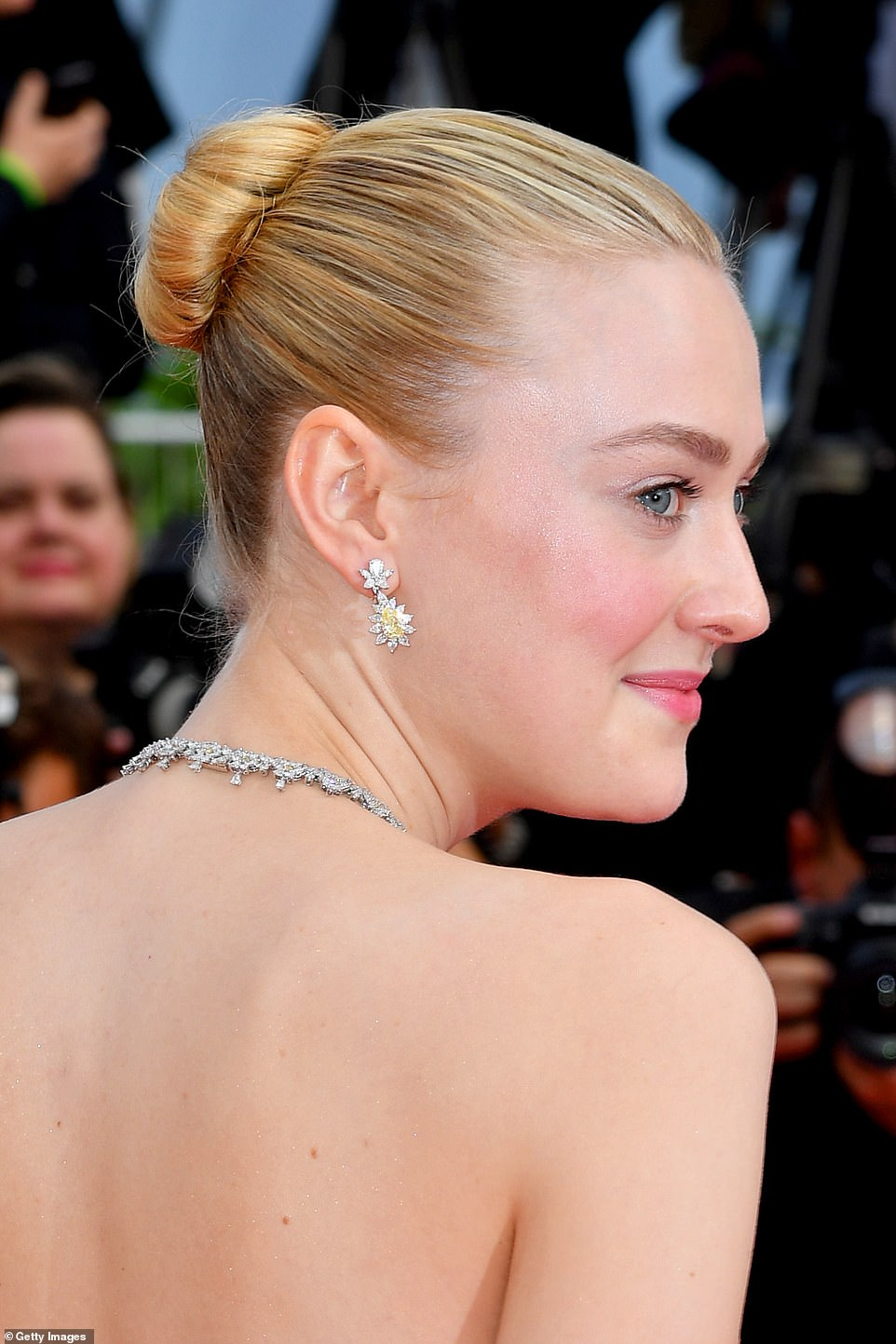 Glamorous: Dakota also added some extra sparkled with some delicate flower jewelled earrings and a matching necklace