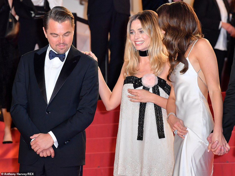 Having a moment: Leo, Margot and Daniela got the giggles before heading into the premiere of the film