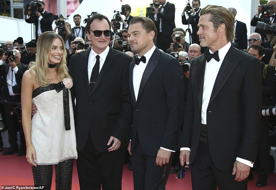 Smartened up: Margot look extra-chic in her sparkling ensemble as she stood next to her male co-stars