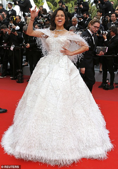 Swanlike: While her dress was dreamy, she opted for a rock star pose