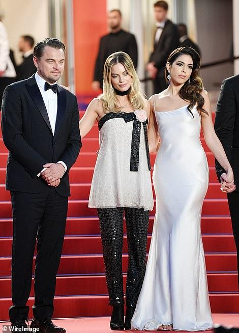 Strike a pose: Leonardo, Margot and Daniela worked their angles for the awaiting paparazzi