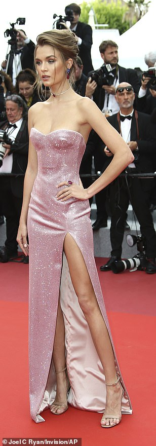 Smouldering: Josephine Skriver looked incredible in a pink gown with a slash along the leg