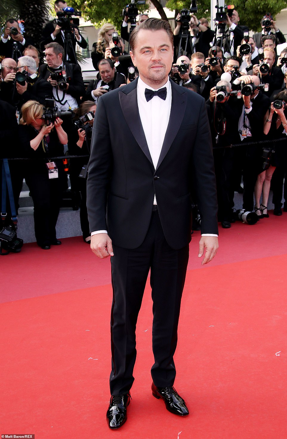 Suave: Leonardo looked as suave as ever in his black sharp suit as he arrived for the star-studded film event after appearing in his second Tarantino film