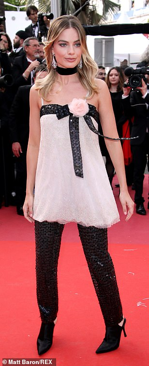 Quirky: Margot opted for the unusual choice of a delicate pink sequinned top