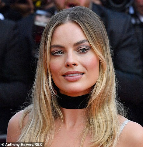 Flawless: Margot also accentuated her flawless complexion with multicoloured eye shadow