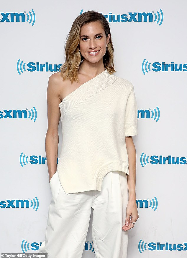 White out: Allison Williams bared a single shoulder in an all-white ensemble while promoting her new movie, The Perfection, in midtown Manhattan on Tuesday