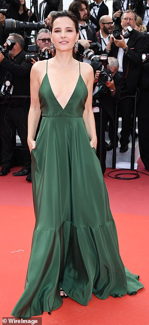Wow! Virginie oozed elegance in a deeply plunging green strappy gown