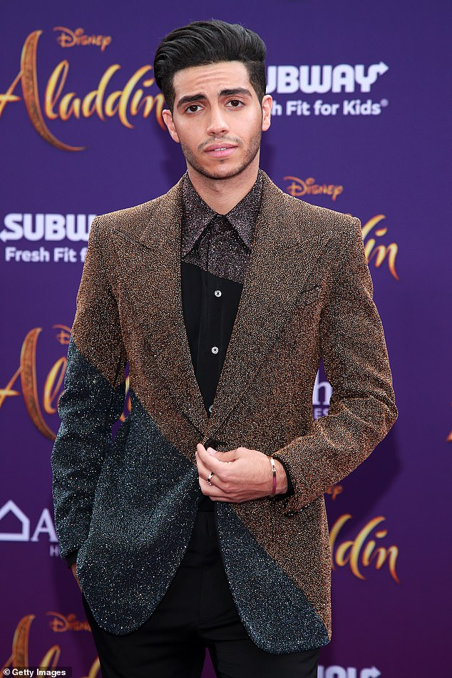 Hello, gorgeous: The Egypt-born Canadian's color-blocked jacket was a complement to his dress shirt, which was part grainy purple and part black