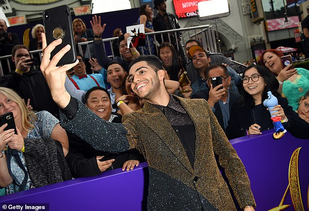 Radiant: The Tom Clancy's Jack Ryan alum flashed his megawatt smile as he leaned back and snapped a selfie that included the fans