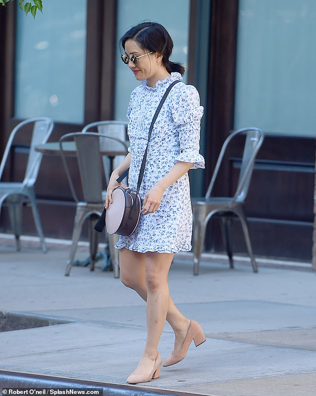 Spring style: Wu, 37, went bare-legged in nude pumps and wore a round purse on a long leather shoulder strap. Her hair was tied back into a ponytail and she sported round sunglasses