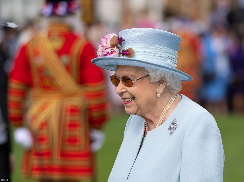 The Queen looked ready for spring in her ice blue coat and hat, which was finished with pink flowers on the brim