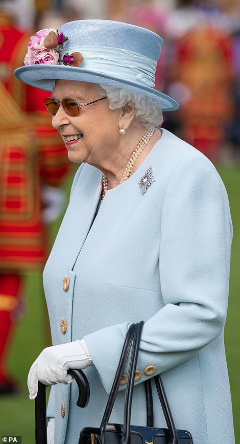 The Queen smiling at the event