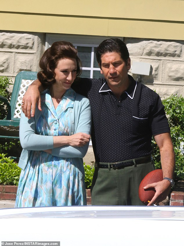 On screen couple:Bernthal was wearing a short-sleeved black collard dress shirt and olive green pants with black shoes, while seen smoking a cigarette on the set