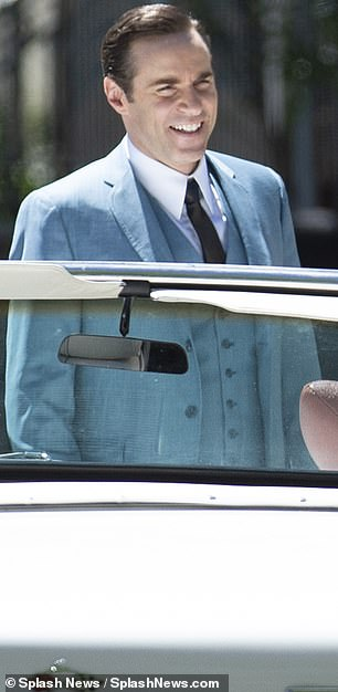 Happy times: Nivola was spotted wearing a sharp, light blue three-piece suit while chatting with Farmiga and Bernthal on the set
