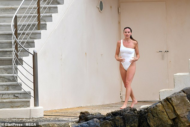 Fun in the sun: The Australian beauty looked thoroughly relaxed as she strolled along the coastline