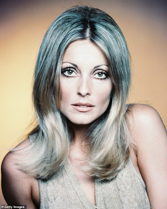 True story: Margot plays actress Sharon Tate, who was brutally murdered when she was eight months pregnant (pictured)
