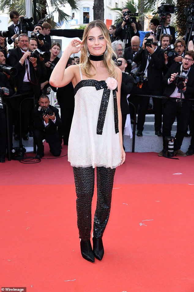 Red carpet ready: Margot glammed up for the premiere in a baby doll top and glittering trousers