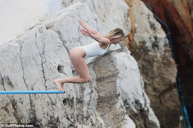 Daring: Margot displayed her amazing physique as she made a dramatic dive into the water