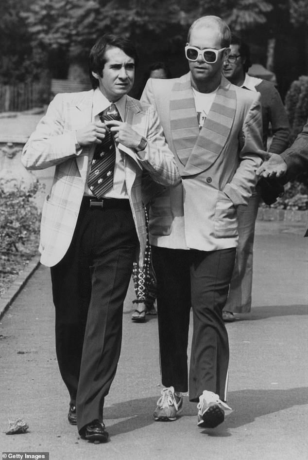 Former flame: The musical icon, 72, revealed he was a 'virgin' and 'desperate to have a tactile relationship' when the pair gave into their impulses in San Francisco (Pictured, Elton and John in 1976)