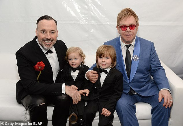 Rescued:Elton also revealed he believes he was rescued from a 'terrible state' when he was 'doing a lot of drugs' by his husband David Furnish, 56, and his sons Elijah, six, and Zachary, eight