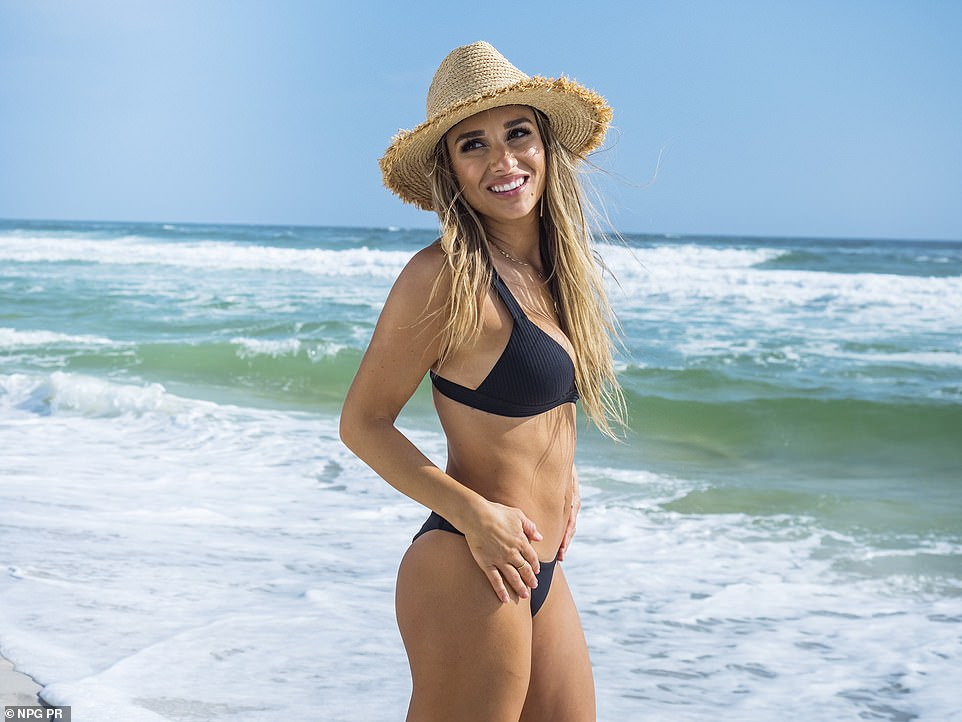 Another look:The Lights Down Low singer was also seen in a revealing black bikini while on a sandy beach. In this photo her hair was down and she added a straw hat