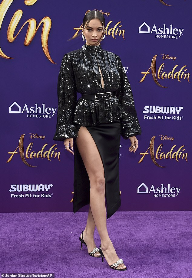 Whole New (World) outfit: Prior to Kylie's launch, Shanina had stunned in a sequinned thigh-split dress when she commanded attention at the Los Angeles premiere of Aladdin