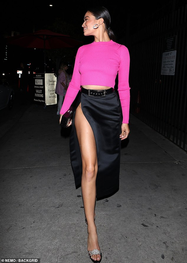 Abs-olutely fantastic! The A-list star brightened up the streets on her departure in a hot pink sweater which had a demure neckline and a cropped hem to tease a look at her stomach