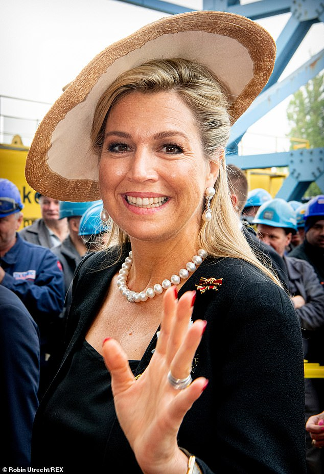 No stranger to a daring piece of headwear, Maxima donned a straw fascinator, over her half pinned back blonde tresses