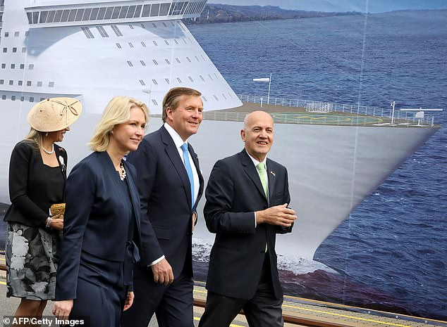 King Willem-Alexander (second right), Queen Maxima (left) and Premier of Mecklenburg-Vorpommern Manuela Schwesig (second left) are guided by MV Werften CEO Peter Fetten (right) during a tour at a shipyard in Rostock