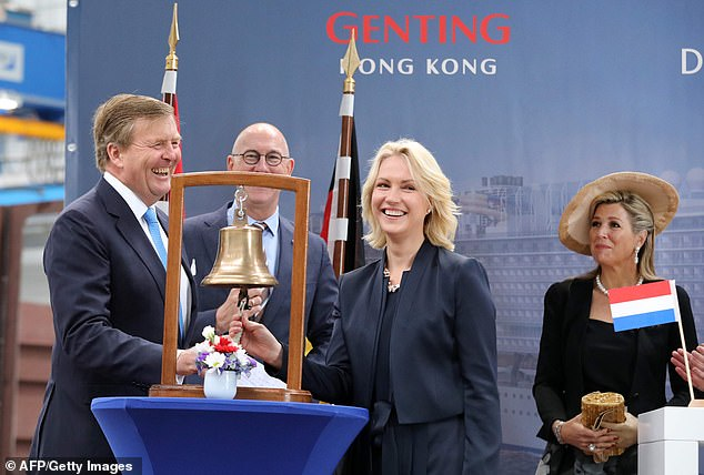 King Willem-Alexander rings a bell to officially launch a cooperation programme between Dutch and German companies