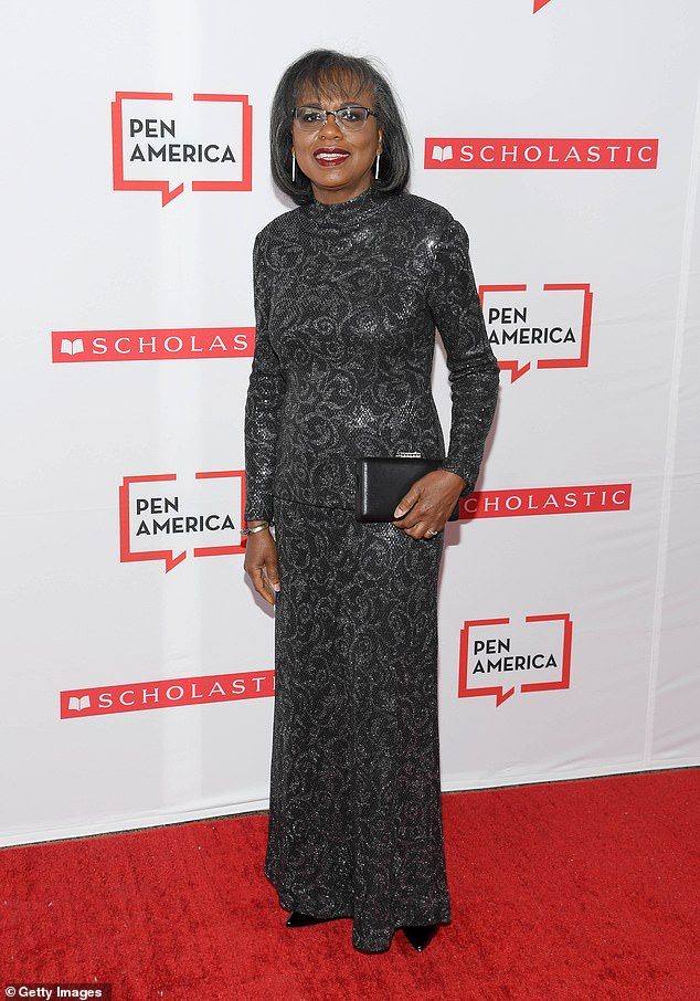 Classy: Anita Hill, 62, looked lovely in a gray patterned ensemble and diamond linear drop earrings