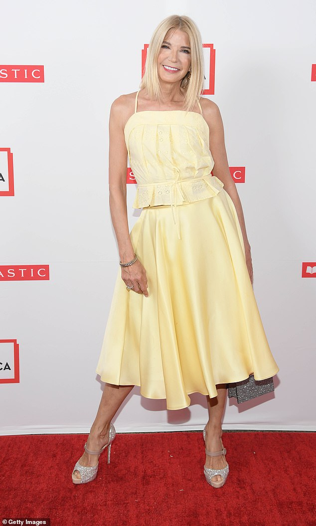 Pretty: Sex And The City author Candace Bushnell was also at the gala and struck a spring style note with a daffodil yellow outfit paired with silver sparkly heels