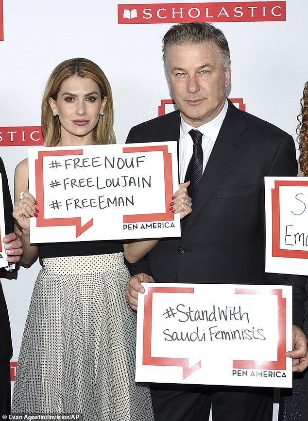 A cause: As they posed for photos, the Baldwins held up signs showing the names of three female writers and activists imprisoned in Saudi Arabia who were being honored in absentia
