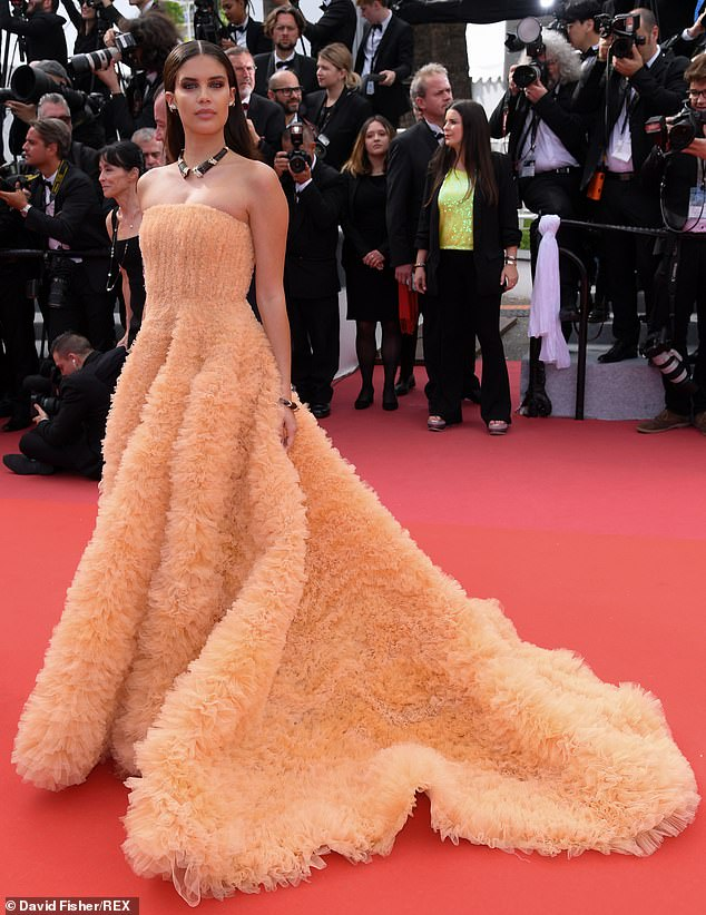 Gorgeous: The Victoria's Secret model turned heads in a strapless tulle gown in a gorgeous peach shade as she walked the red carpet