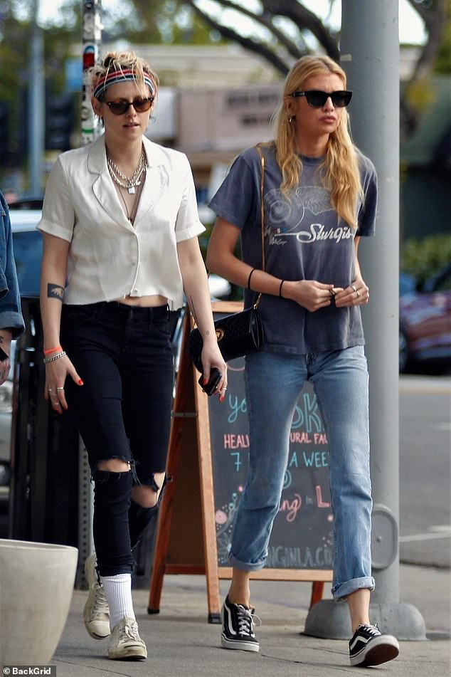 Casual chic: Stella also opted to keep things casual for their walk, as she wore a logo T-Shirt over a pair of denim jeans and paired it with black Vans shoes
