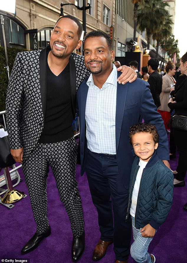 Reunited: Will Smith's Fresh Prince of Bel-Air co-stars Alfonso Ribeiro, 47, and Tatyana Ali, 50, were snapped at the Hollywood premiere of his new film Aladdin at the El Capitan Theatre Tuesday. Smith posed with Ribeiro and his son A.J., five