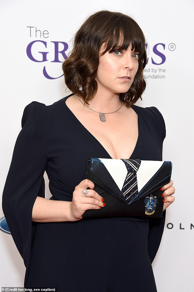 She's a fan: The multitalented 32-year-old held a clutch that looked like the top of the Ravenclaw uniform from the Harry Potter series