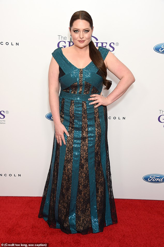 Sensation:Lauren Ash was glamour itself in a glimmering ocean blue frock with see-through strips of black lace running up the skirt