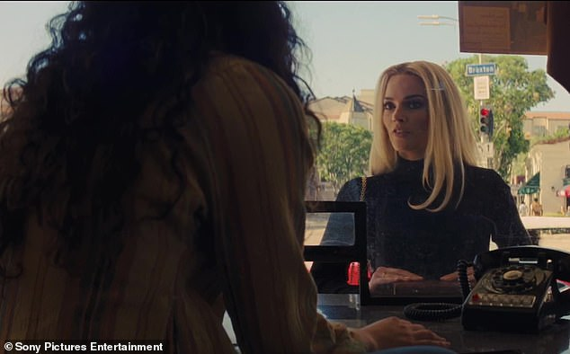 Interesting: Robbie was not featured much in the teaser released two months ago as the new clip showcases more of her portrayal of rising actress Sharon Tate who was murdered by Charles Manson and his 'family' in 1969