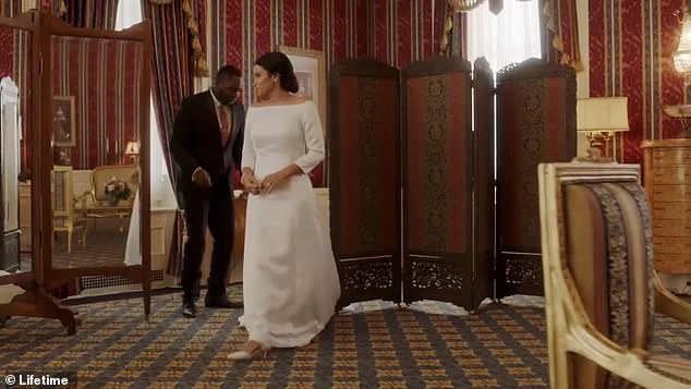 Nerves! Meghan is seen standing in her wedding dress as she takes a deep breath ahead of the biggest royal wedding of 2018