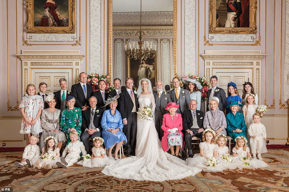 In the traditional royal wedding picture taken in the Duchess of Kent's Drawing Room at Frogmore House, Gabriella and Thomas take centre stage, surrounded by their families.(left-to-right):Back row: Miss Hannah Conolly; Master Ben Conolly; Mr Daniel Crow; Mr Ian Conolly; Mr Oliver Murray; Mr Benjamin Crow; His Royal Highness Prince Michael of Kent; Lord Frederick Windsor; Lady Frederick Windsor; Mr Jamie Campbell; Miss Jessie Conolly; Miss Estella Taylor. Middle row (seated): Mrs Joanna Conolly; Mrs Emma Murray; Mr Martin Kingston; Mrs Jill Kingston; Her Majesty The Queen; His Royal Highness The Duke of Edinburgh; Her Royal Highness Princess Michael of Kent; Her Royal Highness Princess Alexandra; Miss Emily Conolly. Front row (sitting): Master Frederick Murray; Princess Aurelia del Drago; Master Rafferty Murray; Miss Eliza Goldsmith; Miss Maud Windsor; Miss Isabella Windsor; Miss Leonora Weisman; Master Karim Khawaja