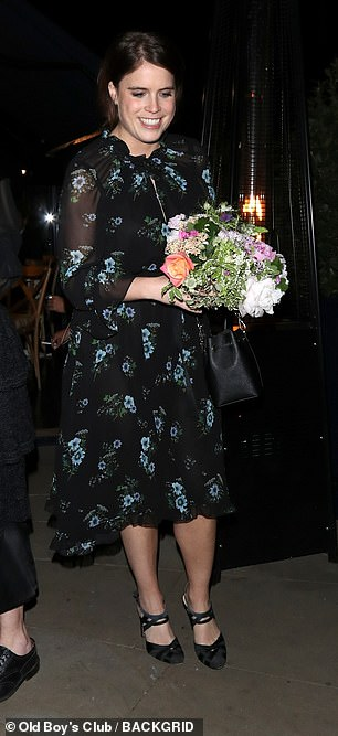 Fun: With her flowers in hand, Eugenie looked in high spirits as she continued on about her day