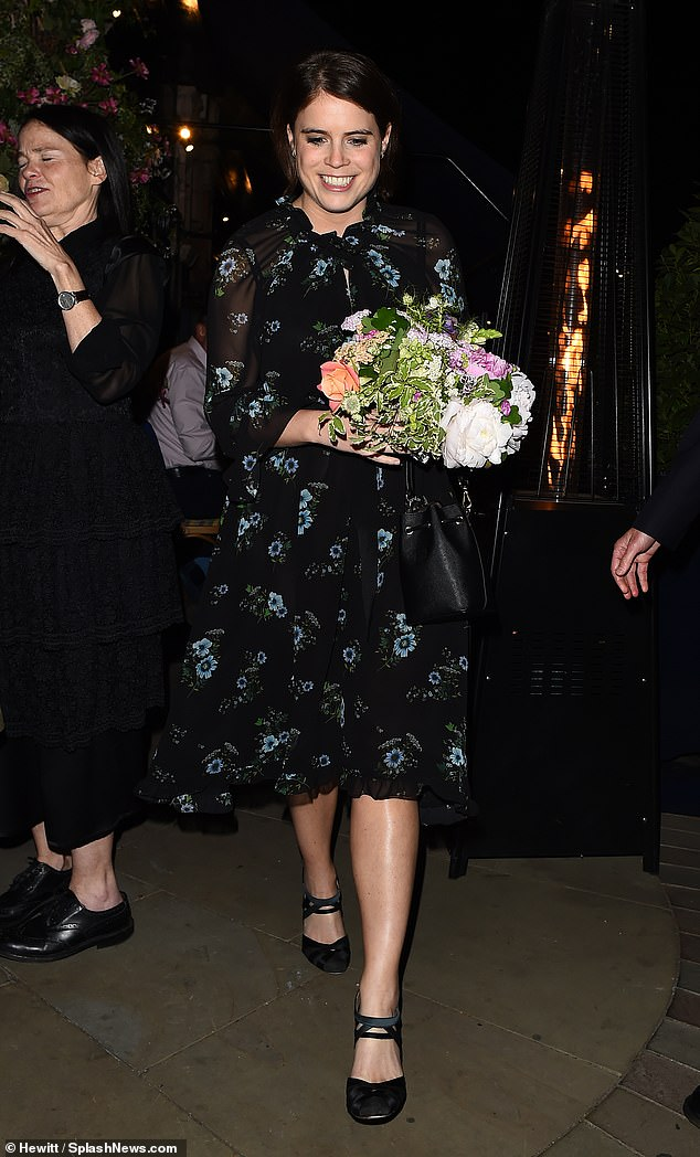 Stylish: Princess Eugenie, 28, cut a solo figure as she left George Restaurant in Mayfair, London with a bouquet of flowers in hand on Tuesday night