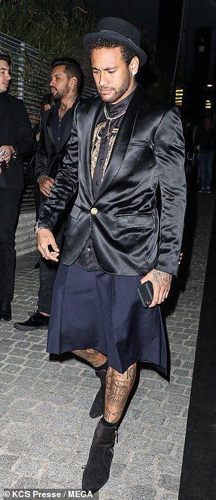 Soccer star: The 27-year-old smoldered for cameras as he posed in a quirky ensemble of black and gold