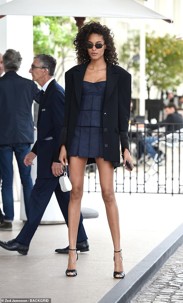Leggy lady: Cindy Bruna put her legs on parade in a thigh-grazing denim pleated minidress