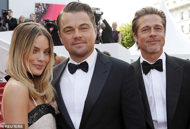 Good pals now: Robbie, DiCaprio and Pitt side by side on the carpet