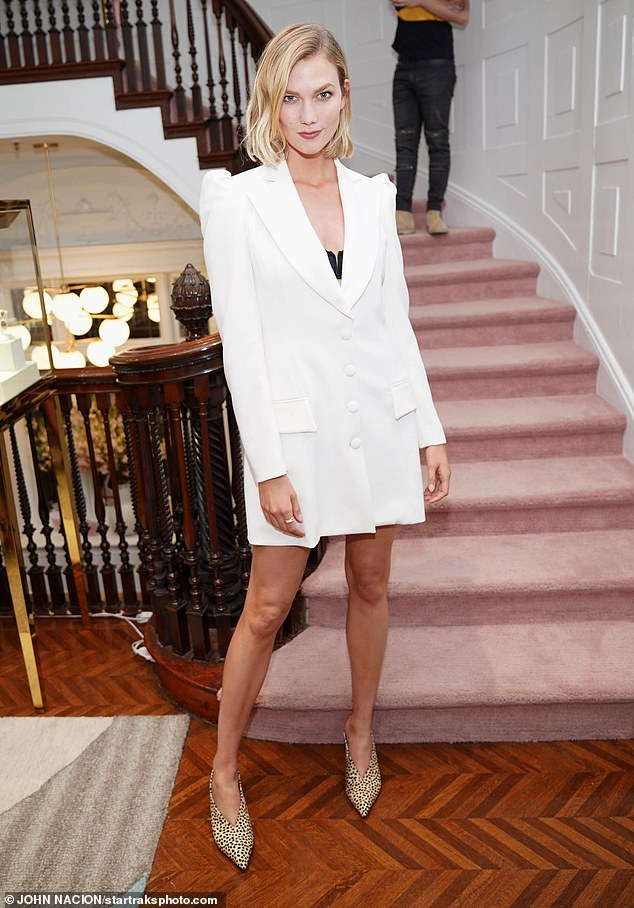 Supermodel chic: The supermodel showed off her fabulous figure as she dazzled onlookers in a white jacket dress