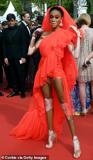 Siren; The star put on an extremely leggy display in the ruffled red gown