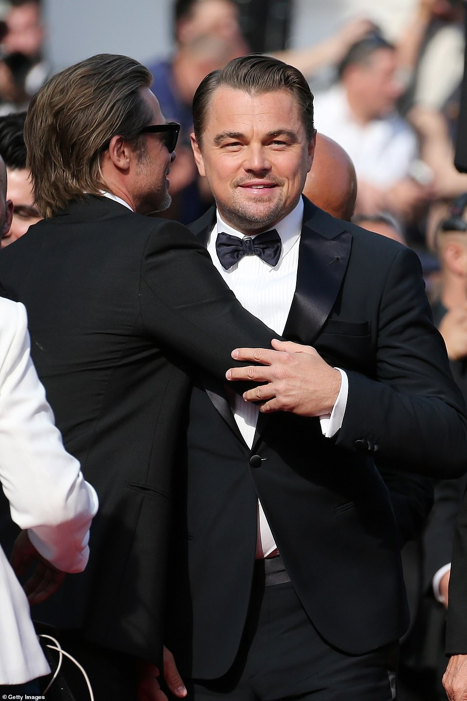 Happy days! The stars of the show Brad Pitt and Leonardo DiCaprio were larking around on the carpet. They play Rick Dalton and his stunt double Cliff Booth, as they revisit a simpler time in tinsel town